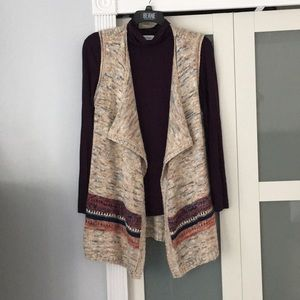 Turtleneck and sweater vest